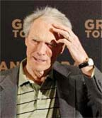 "Director and actor Clint Eastwood poses during a photo call to promote his movie ""Gran Torino"" in Paris February 24, 2009. REUTERS/Benoit Tessier (FRANCE)"