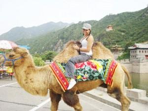 Nicole on camelback in China.