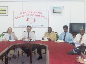 CEO of the Hand-in-Hand Group of Companies, Keith Evelyn (2nd from left) is flanked by (from left) Chairman of Hand-in-Hand Trust Corporation, Paul Chan-A-Sue; Hewley Nelson, General Manager and Director of Hand-in-Hand Trust; Taj Parmessar, Finance Controller of the Corporation and Maurice John, Deputy General Manager and Corporate Secretary.