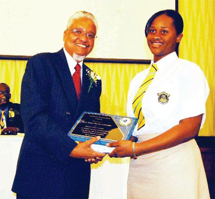 2007 CSEC regional top awardee being honoured by Professor Nigel Harris.