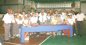 Prize winners of the National Sports Commission (NSC) sponsored Mashramani table tennis tournament and officials of the Guyana Table Tennis Association and NSC after the presentation of prizes on Wednesday at the Cliff Anderson Sports Hall. (Orlando Charles photo)