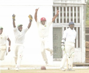 FIRST BLOOD! The Guyana team celebrate the dismissal of opener Kyle Corbin who was caught by wicketkeeper Darwain Christion, centre, off the bowling of Christopher Barnwell for 16. (Aubrey Crawford photo)