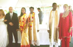 Staff members of the Roraima Group pose in traditional Christian, Hindu and Muslim ceremonial wedding garments.