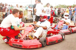 This is what you have to do! Guyana's champion race car driver Mark Vieira is seen in this Orlando Charles photograph explaining to Minister of Culture, Youth and Sports, Dr Frank Anthony what he has to do before he takes the track.
