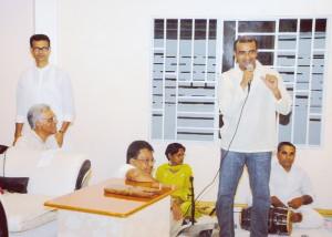 President Bharrat Jagdeo addressing devotees assembled at the Shri Krishna Mandir to celebrate Phagwah. Seated at left is Guyana Hindu Dharmic Sabha President Pandit Reepu Daman Persaud.