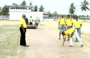 Watched by team coach Ravindranauth Seeram, some players (from left) Steven Jacobs, Christopher Barnwell, Veerasammy Permaul and Sewnarine Chattergoon test the softness of the pitch. (A Calvin Roberts photograph)