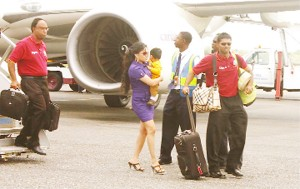 ON HOME TURF! The ICC's number one ranked batsman in test cricket Shivnarine Chanderpaul's makes his way  across the tarmac of the Dr Cheddi Jagan International Airport with wife and son in tow. (Orlando Charles photo)
