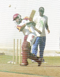 'Ahh, that's how he does it.' These must be the words going through the mind of the gentleman at the back of the nets, as the inform Ramnaresh Sarwan executes a drive. (Photographs by Aubrey Crawford).