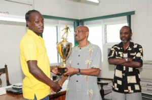 'MVP of the Competition'Pele's Shemroy Arthur (L) receives the Most Valuable Player of the competition award from Mayor of Georgetown Hamilton Green as Head of the Mayor's Cup organizing committee Lennox Arthur looks on. (Clairmonte Marcus photo)