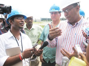 Minister of Agriculture, Robert Persaud (right) and Shadow Agriculture Minister of the PNCR/1G, Anthony Vieira (second from right) speaking to reporters on Wednesday.
