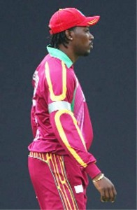 Chris Gayle with the logo on his shirt blocked out by tape.