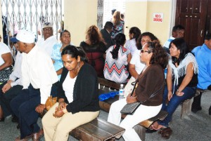 Persons waiting yesterday morning at the Marriage Section of the General Registrar's Office.