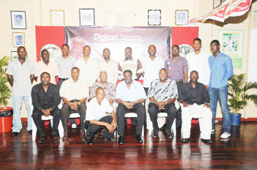 In this Clairmonte Marcus photo,  Clive Lloyd (3rd from right) and Lance Gibbs (4th from left) strike a pose with, from left, Alfred Mentore, Roger Harper, Mark Harper and Garvin Nedd, all stalwarts of Demerara Cricket Club, as well as other club members who are standing behind.