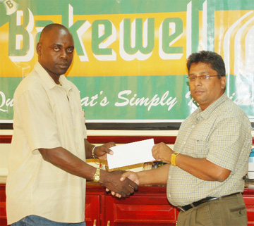 "Bakewell's Manager Rajin Ganga presenting his company's sponsorship cheque to Aubrey ""Shanghai"" Major."