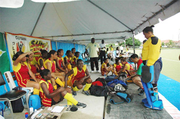 Flash back! National coach Phillip Fernandes talking to his troops at half time against Jamaica in the 2007 edition of the Caribbean Hockey Cup (Photo courtesy of the GHB)