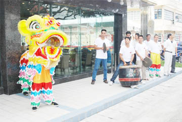 Hear me roar: The Chinese Lion was at the opening of the New Thriving restaurant on Main Street yesterday to welcome guests. (Jules Gibson photo)