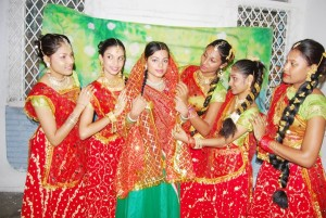 Pretima Prashnajeet (Sita) (third, left) with some of the dancers in the upcoming Ramlila production. (Guyana Hindu Dharmic Sabha photo)