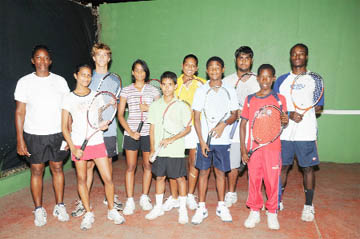 Good luck! National lawn tennis coach Shelly Daly-Ramdhyan (left) poses with the team to Barbados from left (front) Under-14 Krystal Sukhra, Daniel Lopes, Gavin Lewis and Seanden David-Longe. From left (back) Under-19 Jonathan Antczak, Aruna Ramrattan, Tracy Azeez, Rajesh Ramrattan and Jeremy Miller. (Clairmonte Marcus photo)
