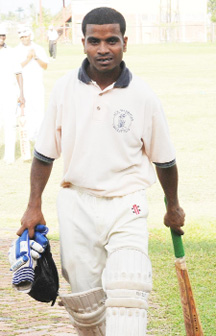 Ace Warriors' opening batsman Abzal Gafoor leaves the field after being the last man dismissed for a well played 97. (A Clairmonte Marcus photo)