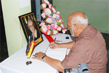 General Secretary of the PPP Donald Ramotar signing the book of condolence yesterday (Photo by Jules Gibson)