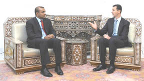President Bharrat Jagdeo (left) in a meeting with Syrian President Bashar al-Assad (GINA photo)