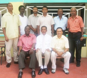 The 2009 GCF executive: Sitting - President Errol Tiwari, centre, is  flanked by (left) secretary Kenrick Braithwaite and (right) treasurer Shiv Nandalall. Standing from l-r are fund-raiser Dennis Dillon, chess trainer Learie Webster, vice-president Omar Sharyff, tournament director Irshad Mohamed, and committee members David Khan and Vishnu Rampersaud.