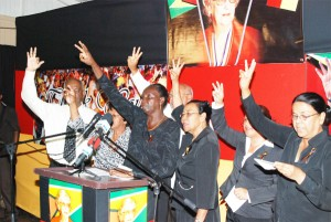 PPP members singing the party's song at yesterday's tribute to Mrws Jagan. (Photo by Jules Gibson)
