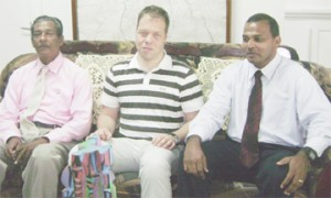 German Grand Master Rainer Buhmann (centre) sits with Minister of Culture, Youth and Sport Dr. Frank Anthony (R) and President of the GCF Errol Tiwari yesterday in the office of the Minister.