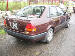 The first vehicle which was hit by the hire car.