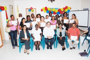 The students pose with their certificates along with their lecturers and invitees. Sitting at centre is Ambassador Dario Morandy.