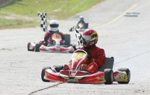Stanley Ming jr. (foreground) and Kristian Jeffrey (behind) hold their chequered flags