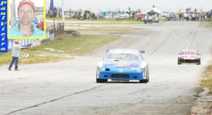Paul Vieira (inset) takes the chequered flag in the first Group '4' race with his younger brother Mark Vieira coming in a distant second. (Orlando Charles photo)