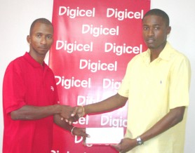 Welcome aboard! Digicel's sponsorship and events executive Sherwin Campbell (left) makes a presentation to NLE Director Travis Shepherd (Orlando Charles photo).