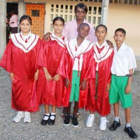 Teacher of Lachmansingh Primary School Constance Mc Calmont with the five top students. From left to right are: Chandini Singh, Bhawani Ramdeo, Ivor Franklin, Kareem Bacchus and Sudesh Jaipersaud.