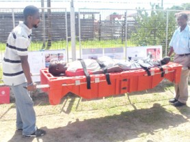 Two University of Guyana students demonstrate the use of the Relief Pod.