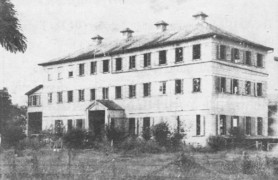 The Ministry of Health building which was destroyed by fire in the early hours of Friday morning, for many years provided a home for Queen's College (above). The school occupied the premises between the years 1918-1951