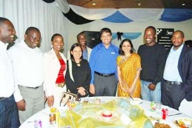 World chess champion Vishy Anand and his wife Aruna, pose for a photograph with executive members of the Botswana Chess Federation. The BCF held a dinner for the champ when he visited Botswana three weeks ago.