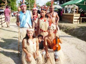This Orealla family walked around the village on Friday playing their instruments and singing as heritage day was celebrated. (See page three) (Sara Bharrat photo)