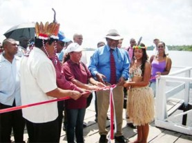 From left are Orealla/Siparuta Toshao Mc Lean De Vair; Minister of Amerindian Affairs Pauline Sukhai; and Prime Minister Sam Hinds as they prepare to cut the ribbon formally opening the $5M wharf at Orealla.