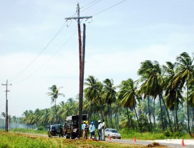 In this photo is the damaged electricity pole at Unity Public Road, Mahaica. The Guyana Power and Light Company crew can be seen making the necessary repairs.