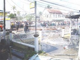 A section of the crowd at the scene of the fire.