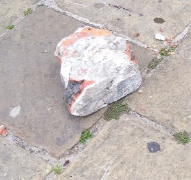 The brick which was allegedly used to strike Hinds