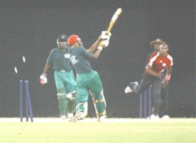 Dwayne Bravo (r) bowls Sauid Drepaul (centre) to wrap up the Guyana  innings at the Providence National Stadium on Friday night. (Orlando Charles)