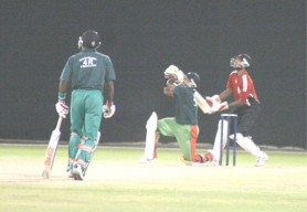 Narsingh Deonarine hits out for another six in his resistant yet futile innings. (Orlando Charles photo)