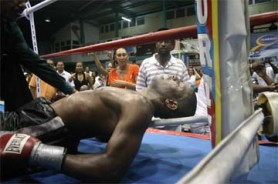 Lights out! Trinidad and Tobago's Kevin Placid is knocked out cold by Howard Eastman in what could have been avoided if referee Eion Jardine had stopped the fight after the first knock down (Orlando Charles photo)