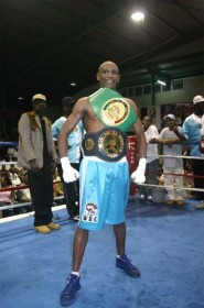 I DID IT! Shondell Alfred proudly displays the world title belt while at right, Leon `Hurry Up' Moore shows off two of the three belts he won on Saturday night at the Cliff Anderson Sports Hall by defeating Mauricio Pastrana of Colombia. (Orlando Charles photos)