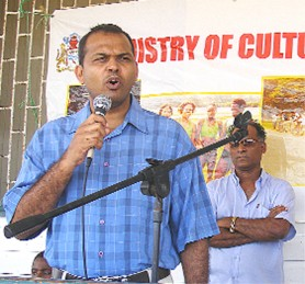 Minister of Culture, Youth and Sport Dr. Frank Anthony addresses the Better Hope community on Sunday's Day of Interaction for villages along the east coast.