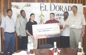 Brand Manager of DDL, Maria Munroe, hands over the sponsor's cheque to GCB Vice President Bissondyal Singh while other GCB executives look on. (Orlando Charles photo)