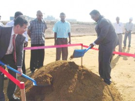 Japanese Counsellor Kiyoshi Takeuchi (left) and Minister of Water Irfaan Ali turning the sod while GWI and other officials look on. (Photo courtesy of GWI)