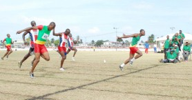 No photo finish in this upset! GDF's Quincy Clarke (right) dips at the line ahead of Rupert Henry (left) and Keith Roberts (centre) in the 200m final of the Joint Services championships yesterday at Camp Ayanganna ground.